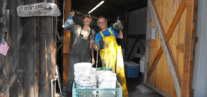 Buck Bay Shellfish Farm - Ladies Holding Oysters & Clams